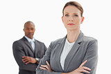Businesswoman with folded arms in front of businessman with fold