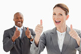 Excited businesspeople with thumbs up 
