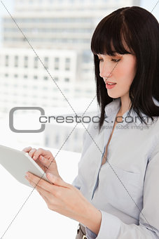 A woman using her tablet pc in her office