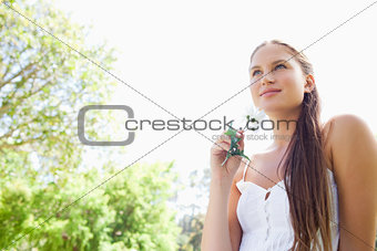 Woman with flower enjoying the day in the park