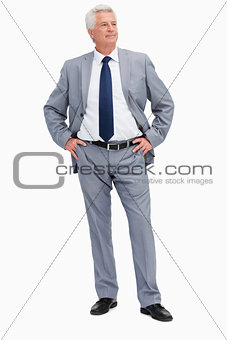 Man in a suit with his hands on his hips