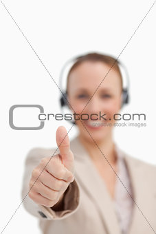 Thumbs up of a businesswoman wearing a headset