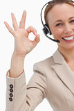 Approbation of a businesswoman with a headset