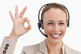 Woman in a suit with a headset approving