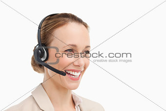 Woman in a suit with headset speaking