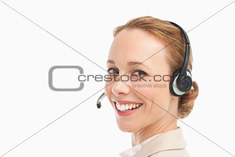 Portrait of a smiling woman in a suit with headset