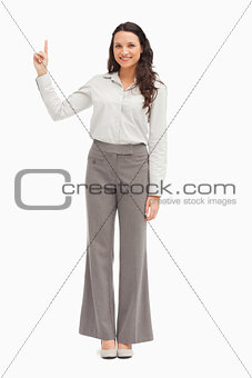Portrait of an employee pointing up