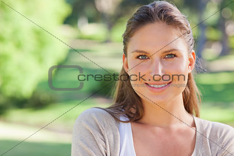 Cheerful smiling woman in the park