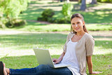 Woman with her laptop sitting on the lawn