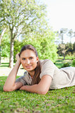 Relaxed woman lying on the lawn