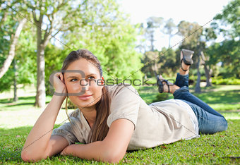 Relaxed woman lying on the grass