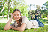 Relaxed woman lying in the park