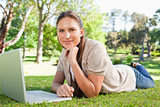 Woman lying on the lawn with her notebook