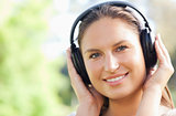 Close up of a woman listening to music in the park