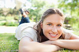 Smiling woman lying on the lawn