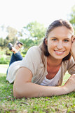 Smiling woman laying on the grass