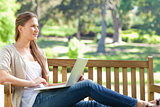 Woman with her notebook on a park bench