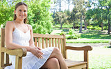 Woman enjoying her day on a park bench