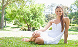 Smiling woman relaxing on the lawn