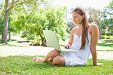 Woman with a laptop on the lawn