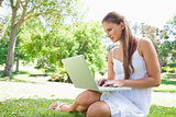 Woman on the lawn with her notebook