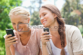Smiling friend with cellphones