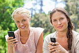 Friends with their cellphones in the park