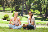 Friends sitting with their books in the park