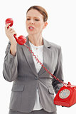 Angry businesswoman shouts at phone