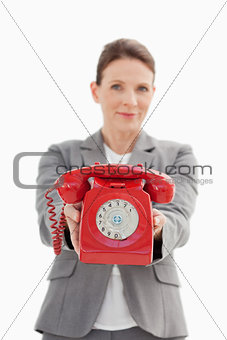 A businesswoman holding a phone