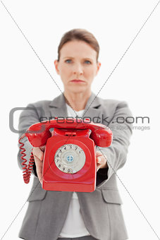 angry businesswoman holding a phone