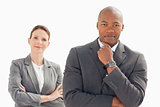 Businessman and woman posing
