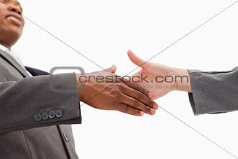 Businessman going  shaking a hand