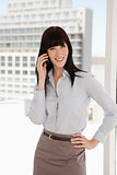 A smiling business woman taking a call