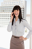Laughing business woman taking a call