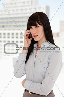 A woman in a suit receiving a phone call