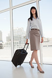 A business woman with a suitcase