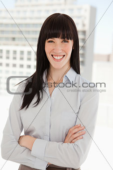 A smiling business woman with her arms folded
