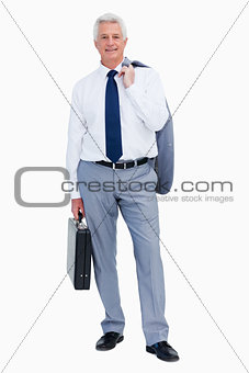 Portrait of a cool businessman with a suitcase