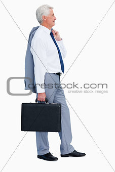 Profile of a cool businessman with a suitcase