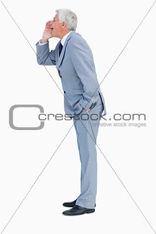 Profile of a businessman shouting