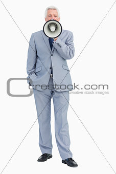Portrait of a businessman shouting with megaphone