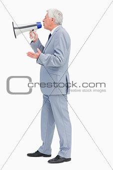 Profile of a businessman speaking with megaphone
