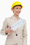 Smiling woman in a suit wearing a safety helmet