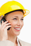 Close-up of a woman wearing safety helmet on the phone
