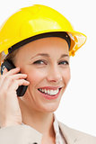 Portrait of a woman on the phone wearing safety helmet