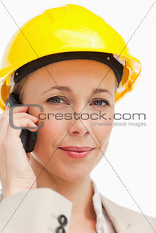 Portrait of a businesswoman on the phone wearing safety helmet