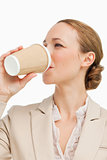 Businesswoman in a suit drinking a takeaway coffee