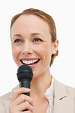Enthusiastic woman in a suit speaking with a microphone 