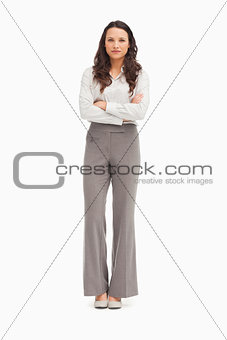 Beautiful employee with folded arms